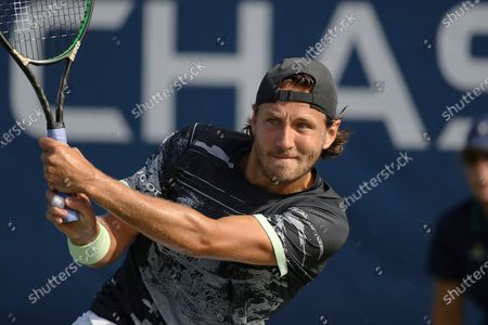 Lucas Pouille, of France, returns a shot to Philipp Kohlschreiber, of Germany, during the first round of the U.S. Open tennis tournament in New York. Former top-10 tennis pro Lucas Pouille will have surgery on his right elbow and miss the return of sanctioned tennis - if the tours do return in August from their pandemic-forced hiatus. The 26-year-old Frenchman said, on Twitter that he would have the operation in Paris this month