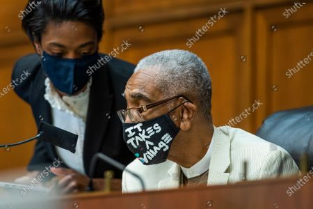 House Commerce Subcommittee Chairman Bobby Rush, D-Ill., confers with an aide during a hearing on oversight of the Department of Energy during coronavirus pandemic on Capitol Hill, in Washington