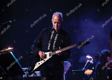 Guitarist Phil Manzanera performing live on stage with Andy Mackay at Queen Elizabeth Hall in London.