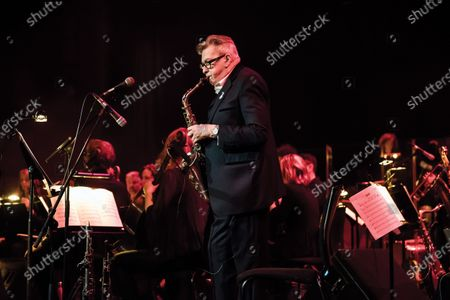 Saxophonist Andy Mackay performing live on stage at Queen Elizabeth Hall in London.