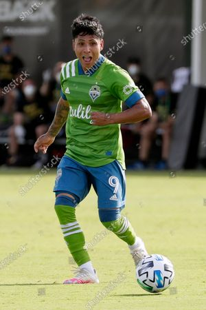 Seattle Sounders forward Raul Ruidiaz (9) moves the ball against the Chicago Fire during the first half of an MLS soccer match, in Kissimmee, Fla