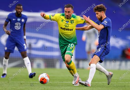 Stock Photo of Norwich City's Josip Drmic, left, battles for the ball with Chelsea's Jorginho during the English Premier League soccer match between Chelsea and Norwich City at Stamford Bridge in London, England