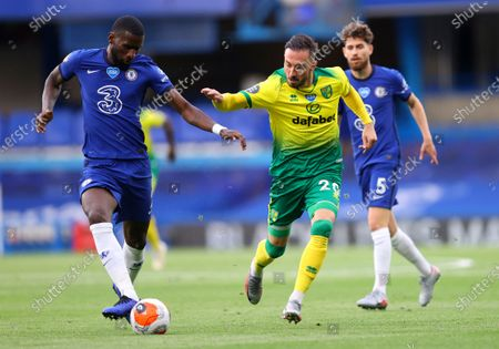 Chelsea's Antonio Rudiger, left, and Norwich City's Josip Drmic battle for the ball during the English Premier League soccer match between Chelsea and Norwich City at Stamford Bridge in London, England