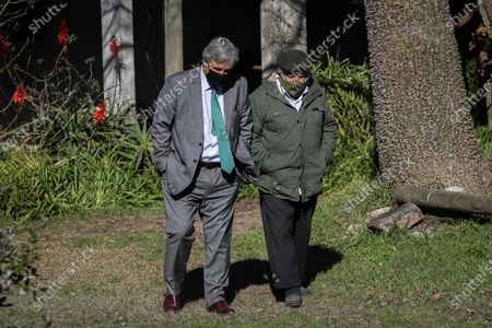 Uruguayan Foreign Minister Francisco Bustillo (L) and former Uruguayan President Jose Mujica (D) walk as they speak in Montevideo, Uruguay, 14 July 2020. Former President of Uruguay Jose Mujica (2010-2015) received this Tuesday at his farm located on the outskirts of Montevideo the new foreign minister of the South American country, Francisco Bustillo, to speak about foreign policy and the upcoming challenges at the international level.