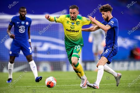 Norwich's Josip Drmic (C) in action against Chelsea's Jorginho (R) during the English Premier League soccer match between Chelsea FC and Norwich City in London, Britain, 14 July 2020.
