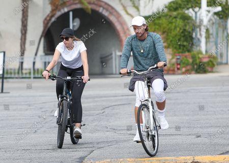 Patrick Schwarzenegger and Christina Schwarzenegger go for a bike ride