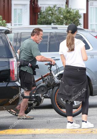 Stock Picture of Arnold Schwarzenegger and Christina Schwarzenegger go for a bike ride