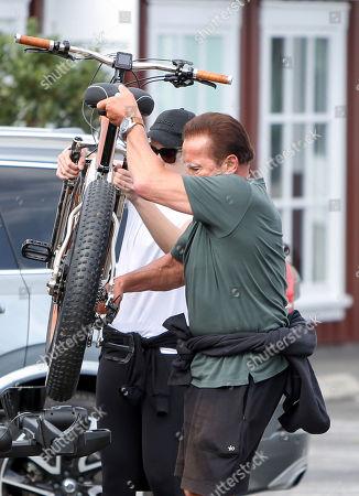 Stock Image of Arnold Schwarzenegger and Christina Schwarzenegger go for a bike ride