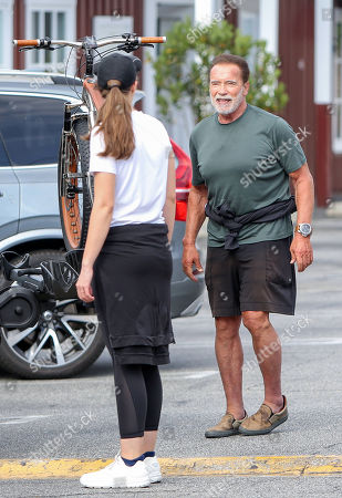 Arnold Schwarzenegger and Christina Schwarzenegger go for a bike ride