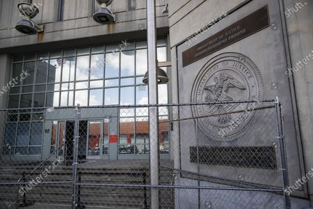 Fencing stands outside the main entrance of the Metropolitan Detention Center, Brooklyn where British socialite Ghislaine Maxwell is held, in New York. Jeffrey Epstein's former girlfriend has been denied bail and will remain behind bars on charges she recruited girls and women for the financier to sexually abuse more than two decades ago