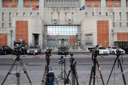 Media outlets set up cameras outside the main entrance of the Metropolitan Detention Center, Brooklyn where British socialite Ghislaine Maxwell is held, in New York. Jeffrey Epstein's former girlfriend has been denied bail and will remain behind bars on charges she recruited girls and women for the financier to sexually abuse more than two decades ago