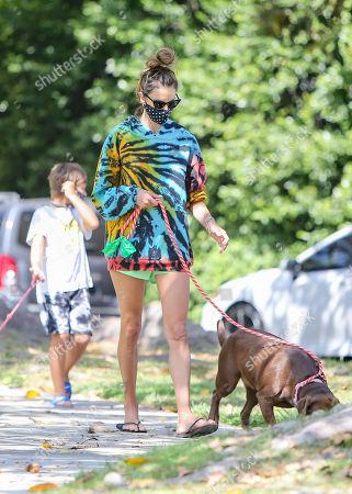 Alessandra Ambrosio walks her dogs with her son Noah Phoenix Mazur