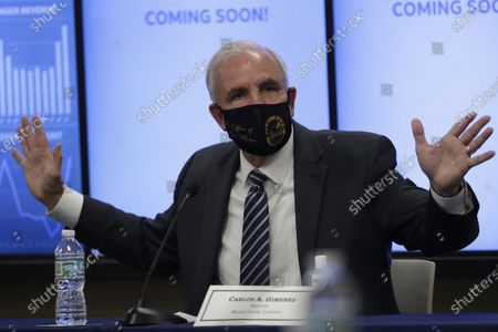 Miami-Dade County Mayor Carlos Gimenez speaks during a roundtable discussion with Florida Gov. Ron DeSantis and Miami-Dade County mayors during the coronavirus pandemic, in Miami