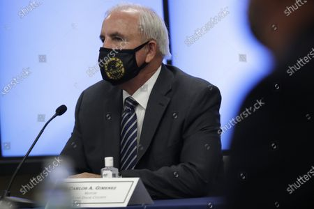 Miami-Dade County Mayor Carlos Gimenez listens during a roundtable discussion with Florida Gov. Ron DeSantis and Miami-Dade County mayors during the coronavirus pandemic, in Miami