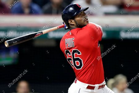 Cleveland Indians' Yasiel Puig watches his ball after hitting the game-winning RBI-single in the 10th inning in a baseball game against the Detroit Tigers in Cleveland. The free agent outfielder and the Atlanta Braves have agreed to a one-year deal, a person with knowledge of the deal said