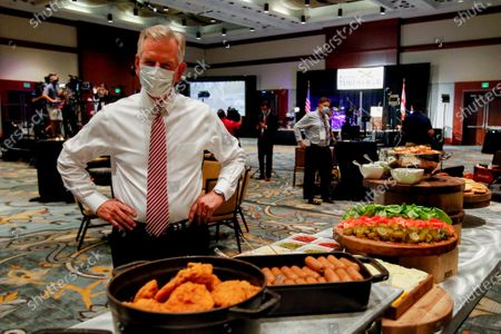 Former Auburn coach, Tommy Tuberville, checks out the buffet table before supporters gather at the Renaissance hotel for a watch party in the runoff election between Senator Jeff Sessions and Tommy Tuberville on Tuesday, July 14, in Montgomery, Ala