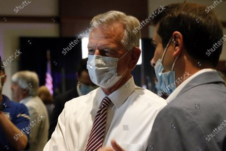 Former Auburn coach, Tommy Tuberville, talks with supporters as they gather at the Renaissance hotel for a watch party in the runoff election between Senator Jeff Sessions and Tommy Tuberville on Tuesday, July 14, in Montgomery, Ala