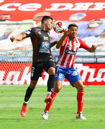 Stock Photo of Emmanuel Garcia (L) of Pachuca vies for the ball with Pablo Barrera of San Luis during during their Copa Telcel friendly soccer match in Leon, Mexico, 14 July 2020.