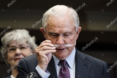 Former United States Attorney General Jeff Sessions (R), accompanied by his wife Mary Blackshear Sessions (L), prepares to give his remarks after losing the run-off election for the Republican Senate nomination for Alabama to Tommy Tuberville in Mobile, Alabama, USA, 14 July 2020. Tuberville will run against incumbent Democratic Senator Doug Jones during the general election in November 2020.