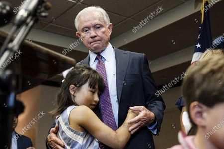 Former United States Attorney General Jeff Sessions hugs his granddaughter after losing the run-off election for the Republican Senate nomination for Alabama to Tommy Tuberville in Mobile, Alabama, USA, 14 July 2020. Tuberville will run against incumbent Democratic Senator Doug Jones during the general election in November 2020.