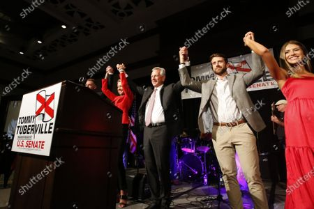 Former Auburn coach, Tommy Tuberville, celebrates with family as he speaks to supporters after he defeated Senator Jeff Sessions in the runoff election on Tuesday, July 14, in Montgomery, Ala
