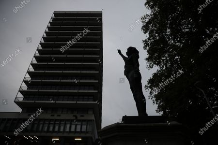 """New black resin and steel statue entitled """"A Surge of Power (Jen Reid) 2020"""" by artist Marc Quinn stands after the statue was put up in the morning on the empty plinth of the toppled statue of 17th century slave trader Edward Colston, which was pulled down during a Black Lives Matter protest in Bristol, England, . On June 7, anti-racism demonstrators pulled the 18-foot (5.5-meter) bronze likeness of Colston down, dragged it to the nearby harbor and dumped it in the River Avon, sparking both delight and dismay in Britain and beyond"""