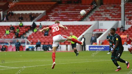 Michael Dawson heads the ball back into the danger area for Forest.
