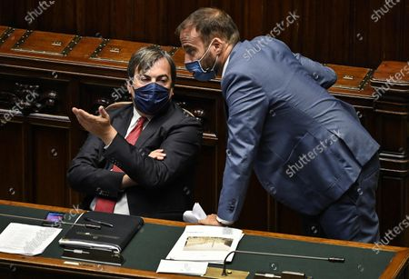 Vincenzo Amendola (L), Italian Minister for Relations with European Union, chats with Luigi Marattin (R), member of Italia Viva party, as they attend a session of the Chamber of Deputies (Camera dei deputati) in Rome, Italy, 15 July 2020.