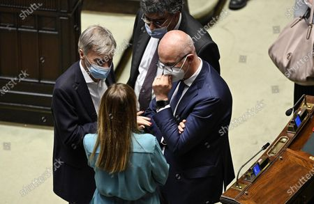 (L-R) Italian deputies Graziano Delrio (Democratic Party), Maria Elena Boschi (Italia Viva), Emanuele Fiano (Democratic Party) and Federico D'Inca (Movimento 5 Stelle) discuss after a session of the Chamber of Deputies (Camera dei deputati) in Rome, Italy, 15 July 2020.