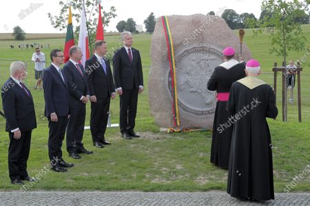 President of the Republic of Lithuania Gitanas Nauseda (4L), Polish President Andrzej Duda (3L), Polish Prime Minister Mateusz Morawiecki (3L) and Lithuanian Prime Minister Saulius Skvernelis (L) during the ceremonial unveiling of the stone commemorating the Battle of Grunwald during a ceremony marking 610 anniversary of the Battle of Grunwald in the fields of Grunwald in Stebark, Poland, 15 July 2020. The Battle of Grunwald (aka the First Battle of Tanneberg) took place on 15 July 1410 between the Kingdom of Poland and the Grand Duchy of Lithuania against the Knights of the Teutonic Order, led by the Grand Master Ulrich von Jungingen. It is regarded as one of the most important battles in Polish history.
