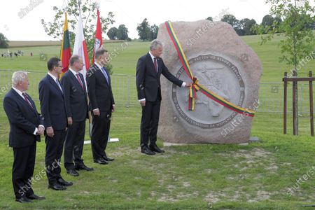 President of the Republic of Lithuania Gitanas Nauseda (R), Polish President Andrzej Duda (2R), Polish Prime Minister Mateusz Morawiecki (3L) and Lithuanian Prime Minister Saulius Skvernelis (L) during the ceremonial unveiling of the stone commemorating the Battle of Grunwald during a ceremony marking 610 anniversary of the Battle of Grunwald in the fields of Grunwald in Stebark, Poland, 15 July 2020. The Battle of Grunwald (aka the First Battle of Tanneberg) took place on 15 July 1410 between the Kingdom of Poland and the Grand Duchy of Lithuania against the Knights of the Teutonic Order, led by the Grand Master Ulrich von Jungingen. It is regarded as one of the most important battles in Polish history.
