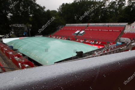 A tennis court for the bett1ACES tennis tournament is covered due to the rain at the Steffi-Graf-Stadium in Berlin, Germany, 15 July 2020. All matches including the men's and women's finals are currently postponed  due to the weather conditions.
