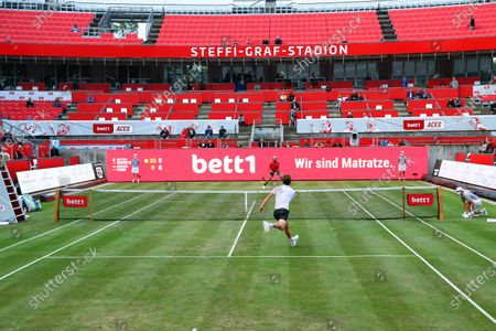 Dominic Thiem (front) of Austria in action against Matteo Berrettini (back) of Italy during their men's final match at the bett1ACES tennis tournament at the Steffi-Graf-Stadium in Berlin, Germany, 15 July 2020. The tournament will be held under strict hygiene restrictions made to cope with the spread of the Coronavirus SARS-CoV-2 which causes the COVID-19 disease.
