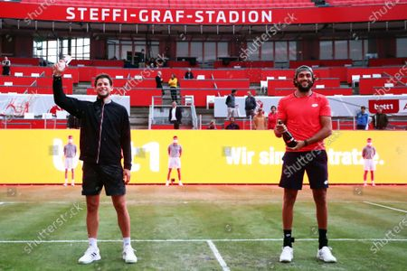Stock Image of Dominic Thiem (L) of Austria celebrates after winning the men's final match against Matteo Berrettini (R) of Italy at the bett1ACES tennis tournament at the Steffi-Graf-Stadium in Berlin, Germany, 15 July 2020. The tournament will be held under strict hygiene restrictions made to cope with the spread of the Coronavirus SARS-CoV-2 which causes the COVID-19 disease.