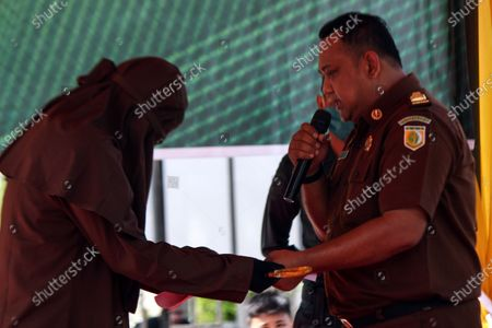 Editorial photo of Lashes for violating Islamic Sharia law in Aceh Utara, Indonesia - 15 Jul 2020