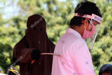 Editorial image of Lashes for violating Islamic Sharia law in Aceh Utara, Indonesia - 15 Jul 2020