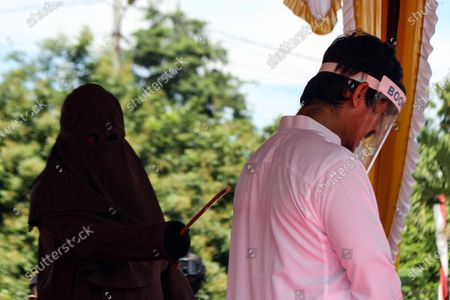 Editorial picture of Lashes for violating Islamic Sharia law in Aceh Utara, Indonesia - 15 Jul 2020