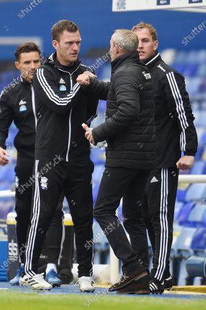 Craig Gardner fo Birmingham City greets Lee Bowyer Manager of Charlton Athletic.
