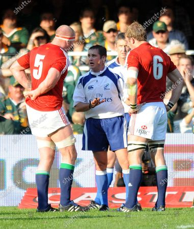 New Zealand referee Bryce Lawrence speaks to Lions captain Paul O'Connell and Tom Croft