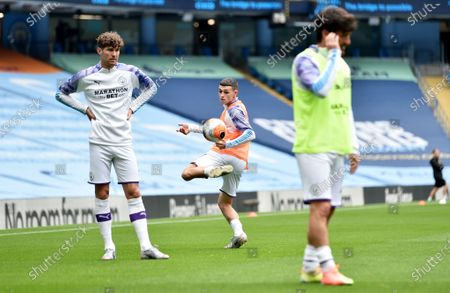 Stock Picture of John Stones (L), Phil Foden (C) and David Silva of Manchester City during the warm-up before the English Premier League match between Manchester City and AFC Bournemouth in Manchester, Britain, 15 July 2020.