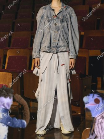 A Model wearing an outfit from the Menswear collections, summer 2021, original creation, from the house of Maison Mihara Yasuhiro