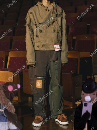 Stock Picture of A Model wearing an outfit from the Menswear collections, summer 2021, original creation, from the house of Maison Mihara Yasuhiro