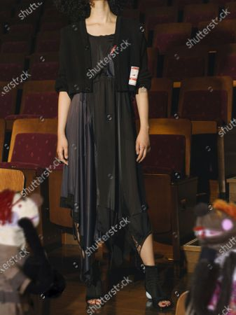 Stock Photo of A Model wearing an outfit from the Menswear collections, summer 2021, original creation, from the house of Maison Mihara Yasuhiro