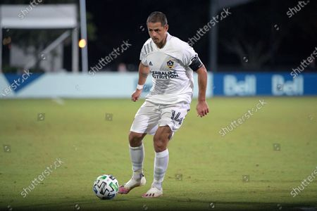 Stock Photo of Galaxy forward Chicharito (14) controls the ball during the second half of an MLS soccer match against the Portland Timbers, in Kissimmee, Fla