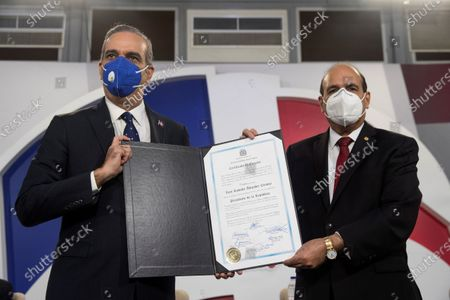 The president-elect of the Dominican Republic, Luis Abinader (L), receives the certificate that accredits him as the winner of the presidential elections of 05 July from the hands of Julio Cesar Castanos (R), president of the Central Electoral Board (JCE) during an act in Santo Domingo, Dominican Republic, 15 July 2020. Abinader, from the opposition Modern Revolutionary Party (PRM) and who won the elections with 52.52% of the votes, according to the final results, will assume power on 16 August in what would be the first change of government in the country since 2004.