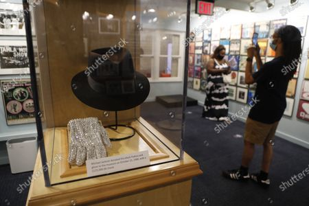 Stock Picture of Michael Jackson's black Fedora and glove are displayed at the Motown Museum, in Detroit. The Detroit building where Berry Gordy Jr. built his music empire reopened its doors to the public on Wednesday. It had been closed since March due to the coronavirus pandemic