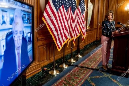 "Rep. Richard Neal, D-Mass., speaks via teleconference, left, as House Speaker Nancy Pelosi of Calif., right, holds a news conference on Capitol Hill in Washington, to mark two months since House passage of ""The Heroes Act"" or the Health and Economic Recovery Omnibus Emergency Solutions act"