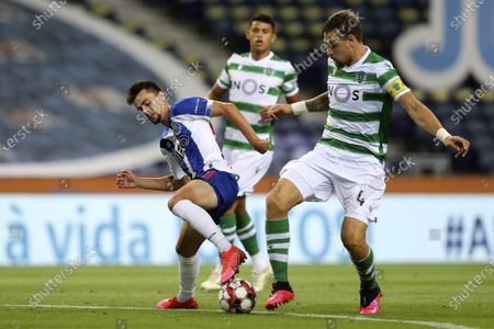 FC Porto's Fabio Vieira (L) in action against Sporting`s Sebastian Coates during the Portuguese First League soccer match between FC Porto and Sporting CP held at Dragao stadium in Porto, Portugal, 15 July 2020.
