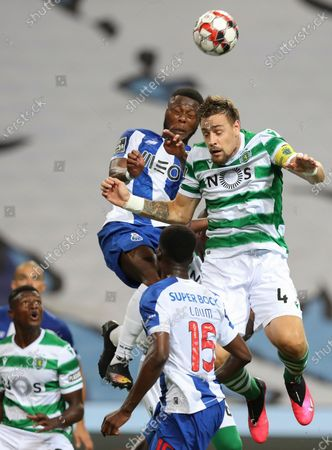 FC Porto's Chancel Mbemba (L) in action against Sporting's Sebastian Coates during the Portuguese First League soccer match between FC Porto and Sporting CP held at Dragao stadium in Porto, Portugal, 15 July 2020.