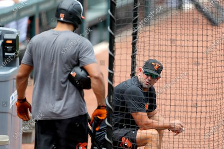 Baltimore Orioles manager Brandon Hayes, right, talks with Anthony Santander during baseball training camp, in Baltimore